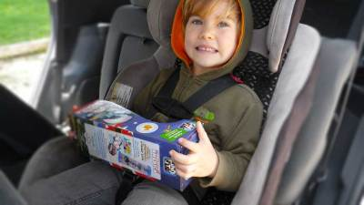 Oliver in the car enjoying Find It Discover America