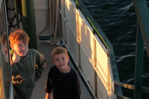 River and Ollie looking off the bow (or front) of the Breezy Belle