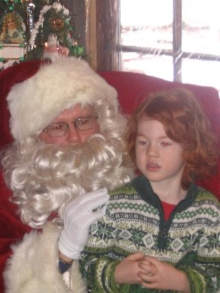 Keller with Santa at Shake Rag Alley Center for the Arts