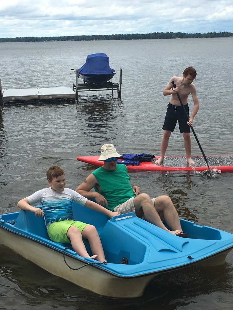 Matty, River on the peddle boat and Keller on a paddle board