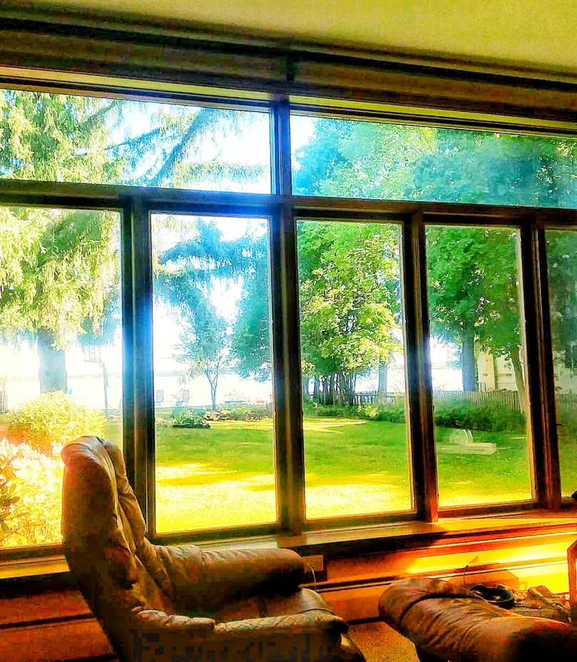 Big windows from our family room looking out in Lake Mitchell