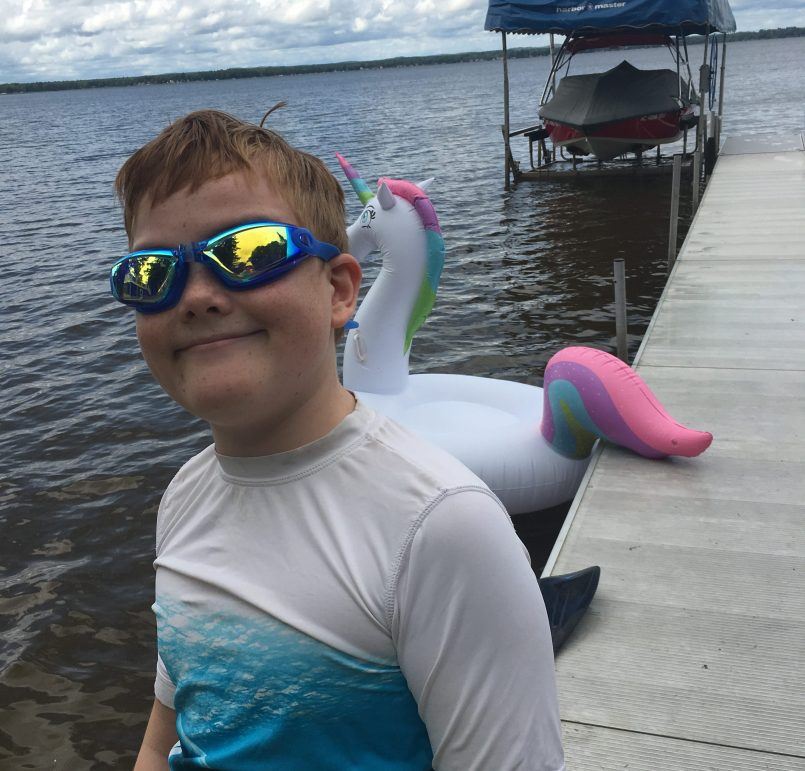River in his cool shades on Lake Mitchell, MI